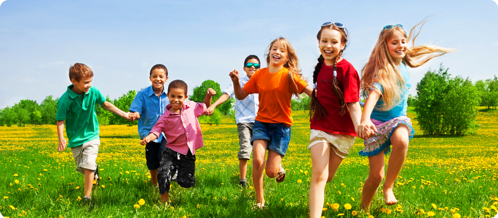 Children running in a flower field