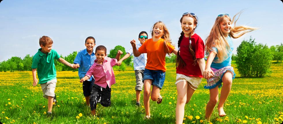 Children running in a flower field